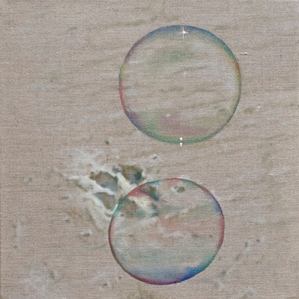 Soap Bubbles: soap bubble landing on paw print in beach sand