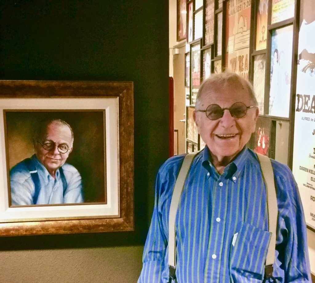 Jack Freimann with his portrait installed at Harper Joy Theatre Whitman College